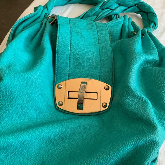 CharmingCharlie's teal oversized bag,braided strap